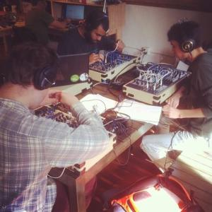 This picture was taken one afternoon when we were given free time to patch and experience the modular synthesizers made by Make Noise. From left to right: Asher Hill, Matt Sherwood (in the back), Safarii Urena, and me.
